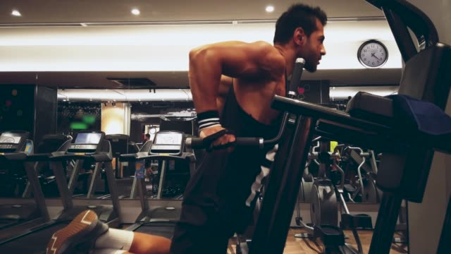 fitness instructor working out, dips bodyweight exercise in health club - bicep stock videos & royalty-free footage
