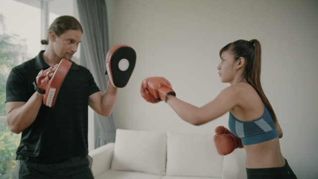 fitness man and fitness woman exercise by boxing - glove fist stock videos & royalty-free footage