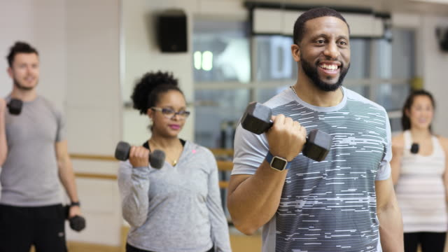 fitness smiles - bicep stock videos & royalty-free footage