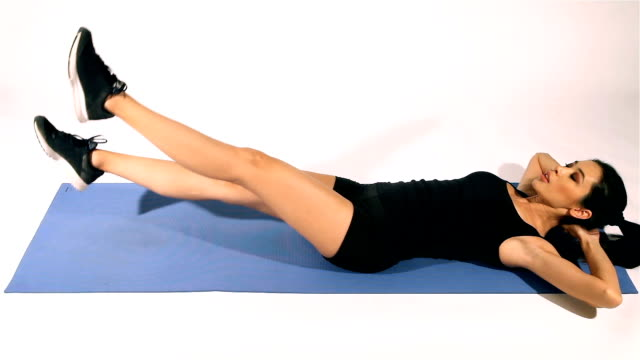 fitness woman doing sit-ups and abs workout - alternating beat abs - washboard stock videos and b-roll footage