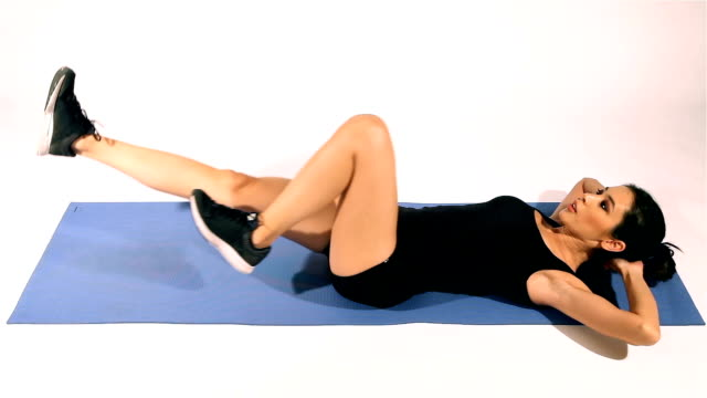 fitness woman doing sit-ups and abs workout - cycling abs - washboard stock videos and b-roll footage