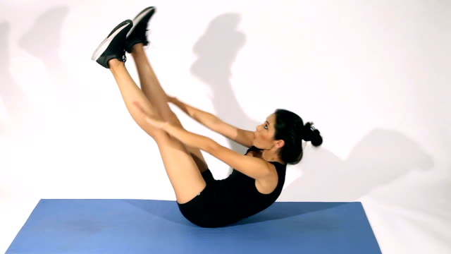 fitness woman doing sit-ups and abs workout - v-ups - washboard stock videos and b-roll footage