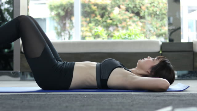 Fitness woman doing stretching in gym