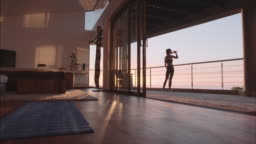 Fitness woman doing stretching in living room