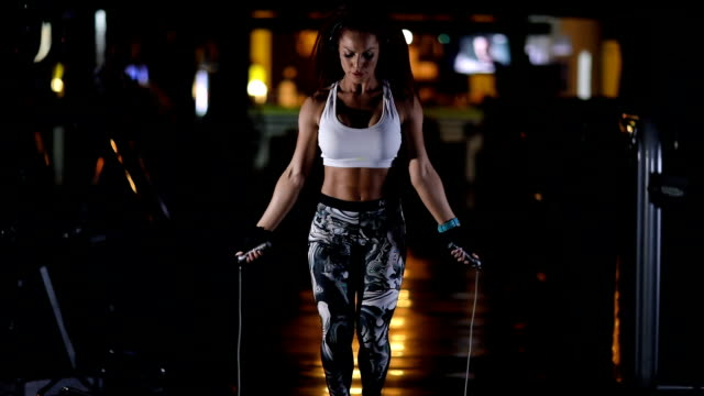 fitness woman jumping the rope in gym - human limb stock videos & royalty-free footage