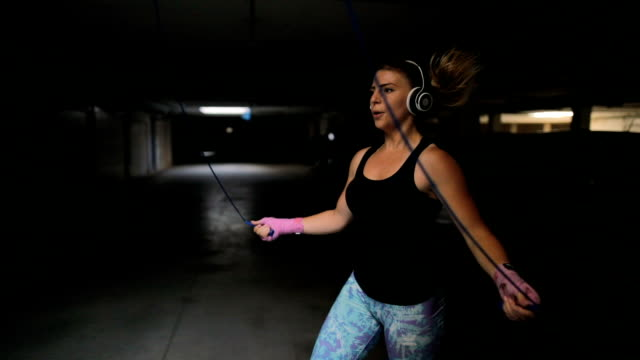 fitness woman jumping the rope - skipping stock videos & royalty-free footage