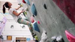 Fitness Woman on Climbing Wall