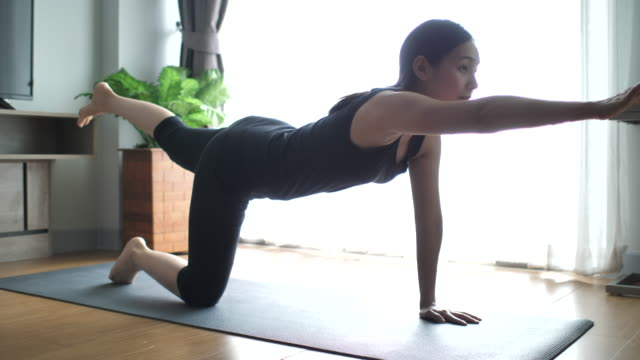 fitness woman performing exercise - bodyweight training stock videos & royalty-free footage