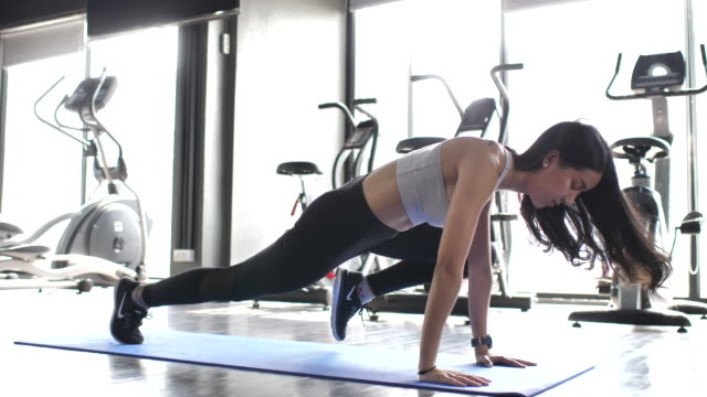 fitness woman sports training on the floor - plank stock videos & royalty-free footage