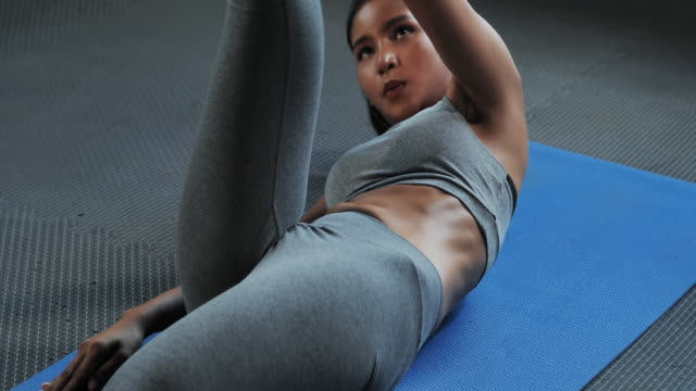 fitness woman working out on core muscles at gym.bodybuilding gym training routine.women in sport - exercise mat stock videos & royalty-free footage