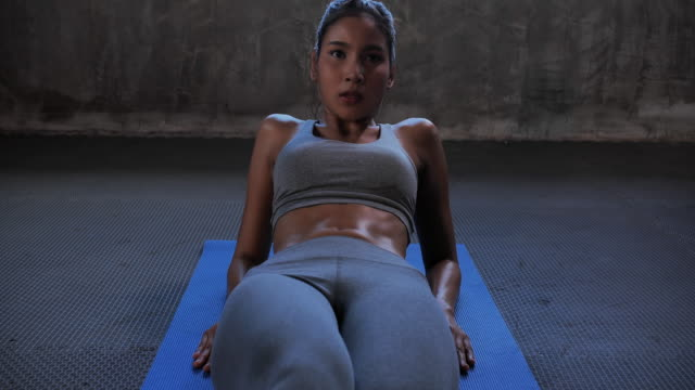 fitness woman working out on core muscles at gym.bodybuilding gym training routine.women in sport - sit ups stock videos & royalty-free footage