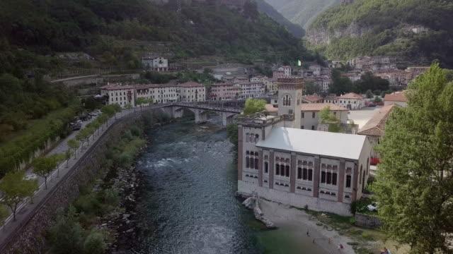 fiume brenta con vista su ponte e citta' di valstagna - ponte stock videos & royalty-free footage