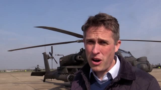 five apache attack helicopters take off from wattisham airfield in suffolk on a threemonth deployment to estonia as a deterrent to the threat from... - アパッチヘリコプター点の映像素材/bロール