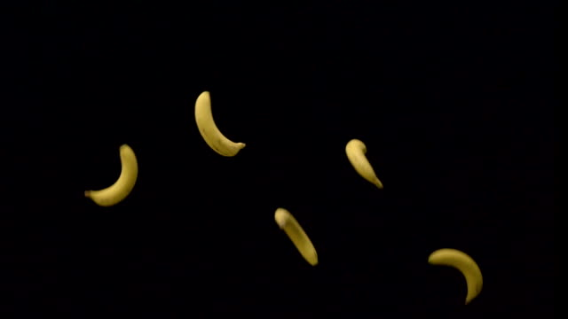 Five banana flying up and down Slow motion