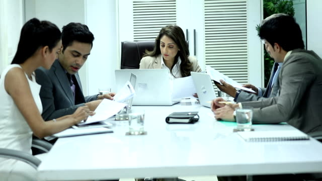 five business people doing meeting in the office, delhi, india - indian subcontinent ethnicity stock videos & royalty-free footage
