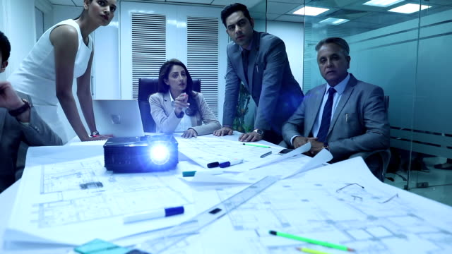 five business people watching presentation on a projector, delhi, india - board room stock videos & royalty-free footage
