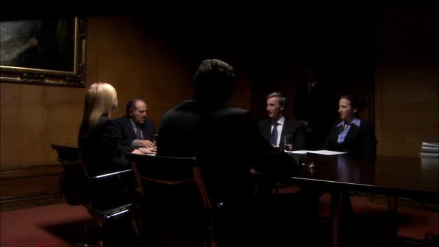 MS five businesspeople having meeting in board room/ London