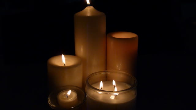 five candles burning - votive candle stock videos and b-roll footage