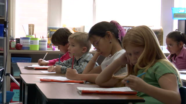 ms, five children (6-7, 8-9) at desks in classroom - texas stock-videos und b-roll-filmmaterial