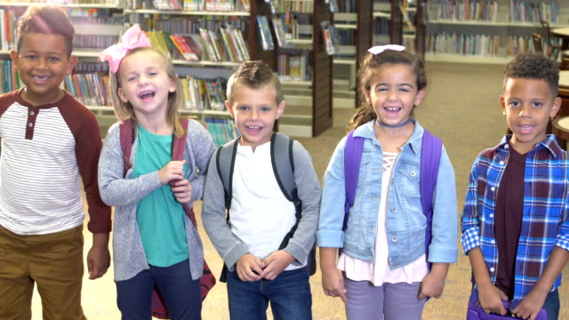 five children in school library - 6 7 years stock videos & royalty-free footage