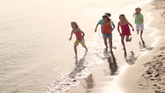 five children running on beach. - five people stock videos & royalty-free footage