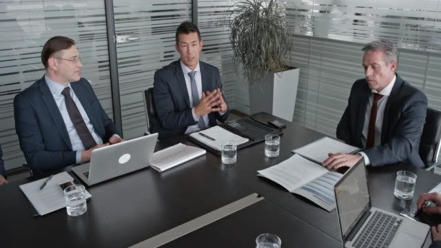 cs five directors in a meeting with the ceo in the conference room - sala conferenze video stock e b–roll
