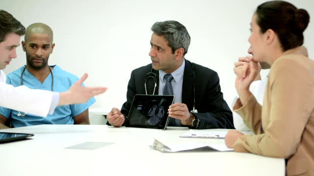 five doctors using digital tablet - medical student stock videos and b-roll footage