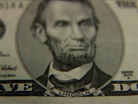 vídeos y material grabado en eventos de stock de ecu, r/f, five dollar bill - billete de cinco dólares estadounidense