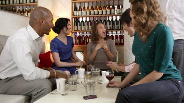 five friends celebrate birthday in cafe - ワインバー点の映像素材/bロール