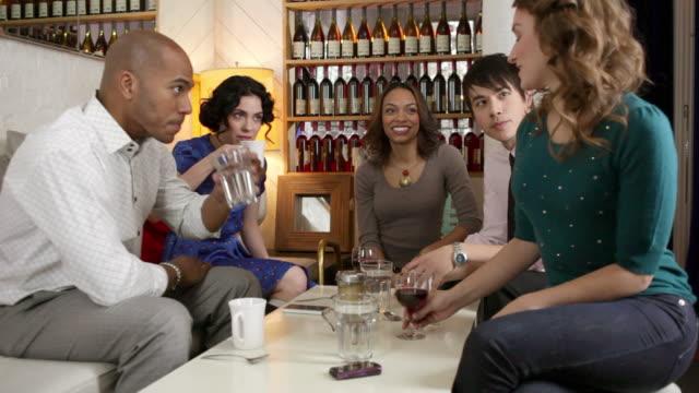 five friends relaxing in cafe - ワインバー点の映像素材/bロール