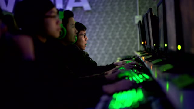 five gamers team in a row at internet game cafe - five people stock videos & royalty-free footage
