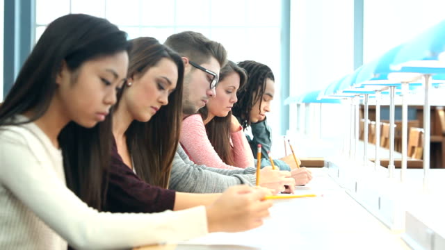 five high school or college students taking a test - exam stock videos & royalty-free footage