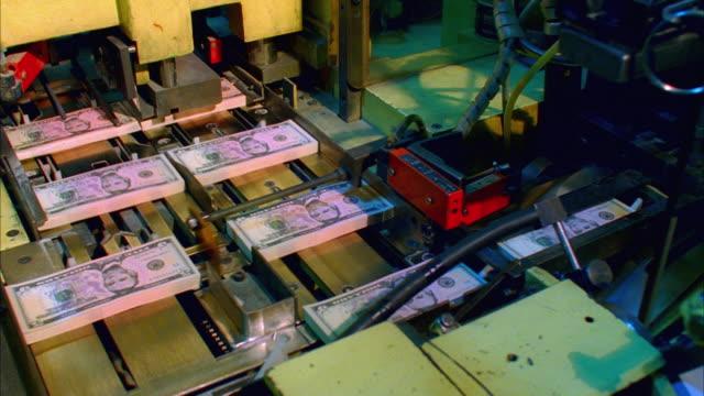 CU, HA, Five hundred American dollar bundles being separated on cutter, Washington DC, USA
