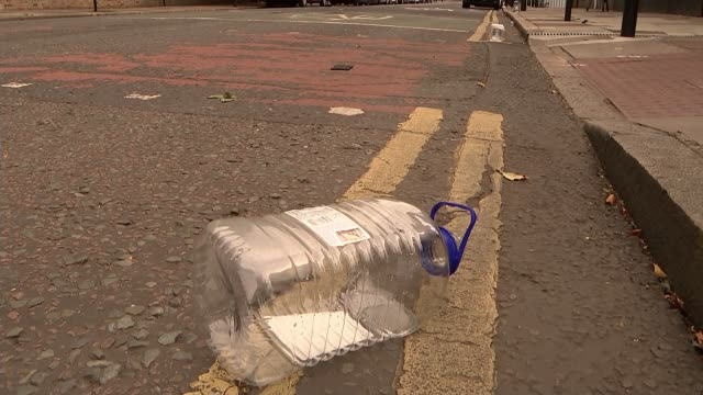 Five hurt in spate of acid attacks in North London ENGLAND London Hackney EXT GV traffic junction Plastic bottle and lids lying on pavement/ Sadiq...