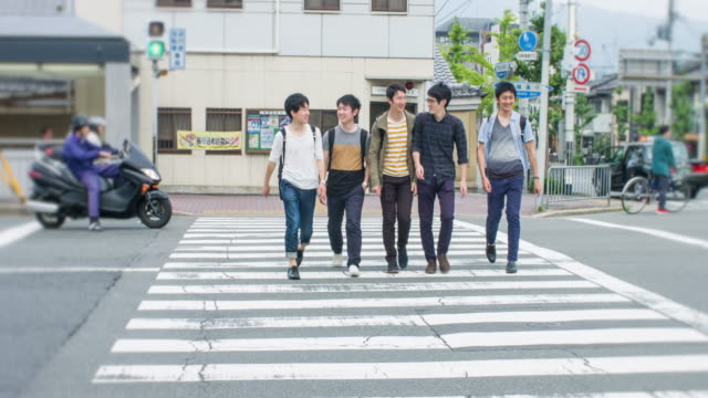 five japanese students crossing the street going to the university - five people stock videos & royalty-free footage