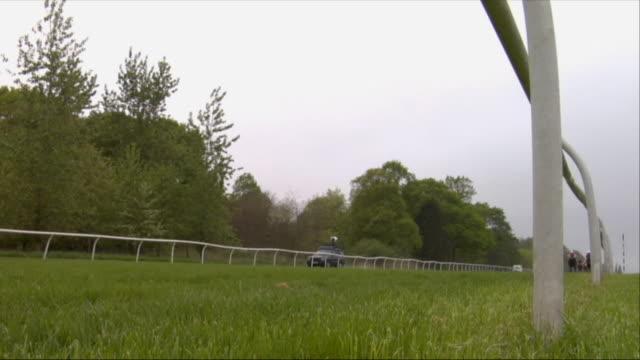 sm la ws five jockeys on horses running near road during race at newbury racecourse / newbury, england, uk - newbury england stock videos & royalty-free footage