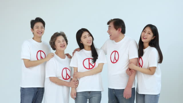 five koreans smiling brightly for encouraging people to vote on election day - general election stock videos & royalty-free footage