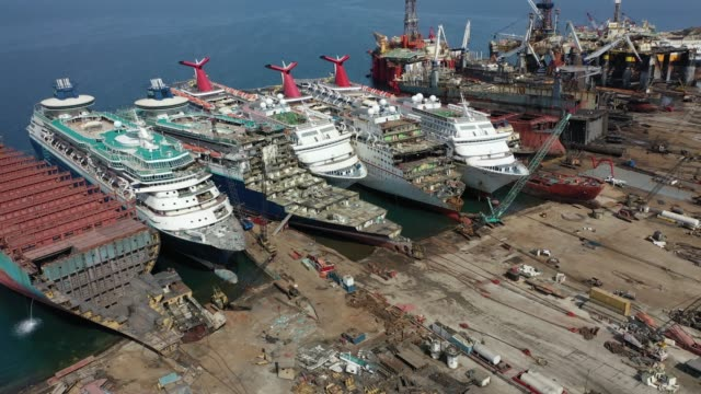 five luxury cruise ships are seen being broken down for scrap metal at the aliaga ship recycling port on october 02, 2020 in izmir, turkey. with the... - kreuzfahrt stock-videos und b-roll-filmmaterial