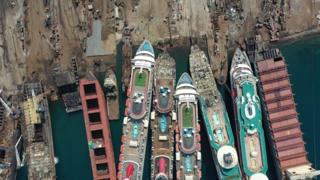 five luxury cruise ships are seen being broken down for scrap metal at the aliaga ship recycling port on october 02, 2020 in izmir, turkey. with the... - epidemic stock-videos und b-roll-filmmaterial