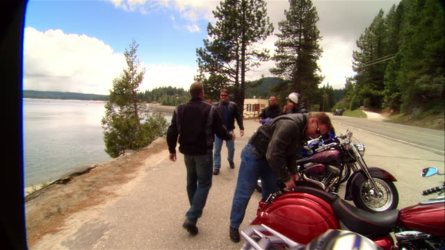 ms pan five men w/ motorcycles enjoying scenic roadside lookout over lake/ fresno county, california - 30 34 years stock videos & royalty-free footage