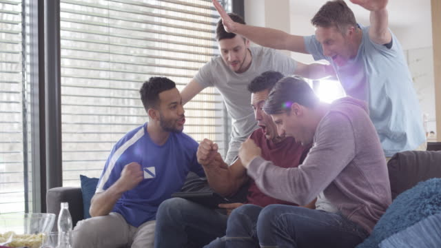 five men watching a game on the digital tablet - match sport stock videos & royalty-free footage