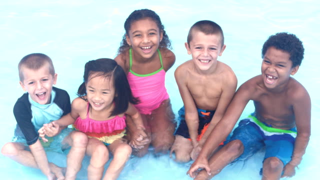 five multi-ethnic children in swimming pools laughing - 8 9 years stock videos & royalty-free footage