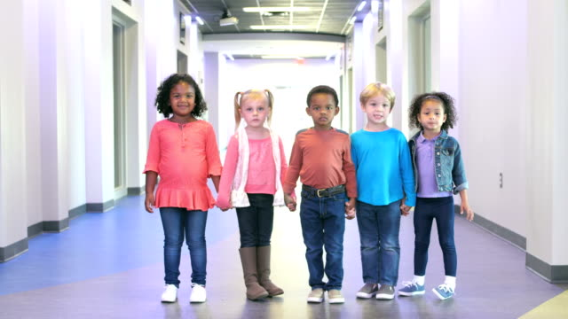 five multi-ethnic preschool children holding hands - 4 5 years stock videos & royalty-free footage