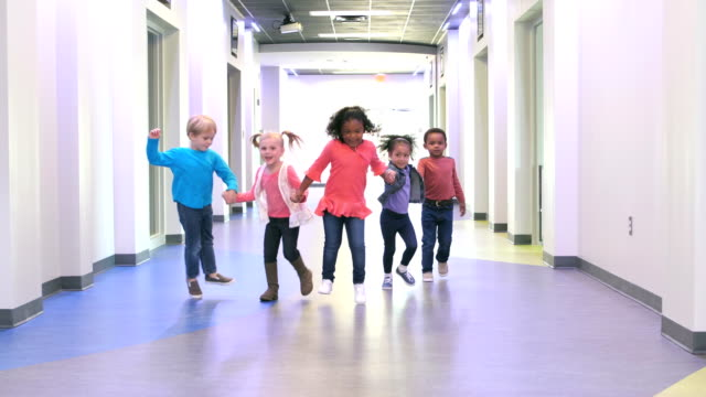 five multi-ethnic preschool children holding hands - people in a row stock videos & royalty-free footage