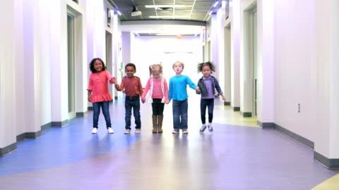 five multi-ethnic preschool children holding hands - holding stock videos & royalty-free footage