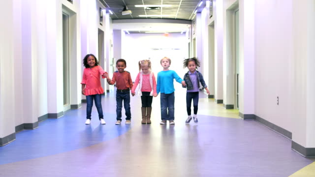 five multi-ethnic preschool children holding hands - holding stock videos & royalty-free footage