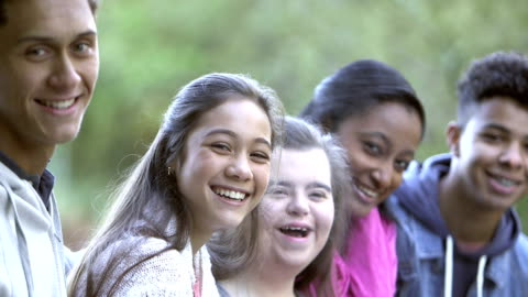 five multi-ethnic teenagers, girl with down syndrome - teenagers only stock videos & royalty-free footage