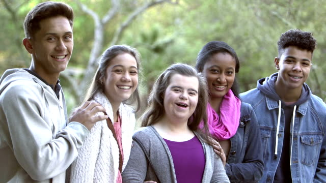 Five multi-ethnic teenagers, girl with down syndrome
