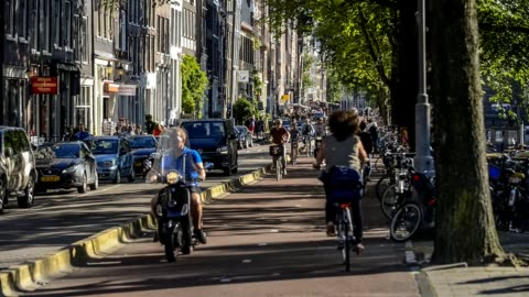 five o'clock rush hour in amsterdam, gelderse kade. commuters on bicycles riding back home after a work - amsterdam stock videos & royalty-free footage