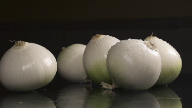 five onions - five objects stock videos & royalty-free footage